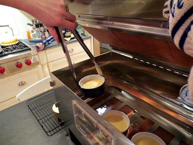 Placing ramekins in the HERC Oven