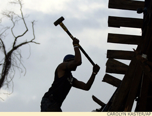 Volunteer rebuilding New Orleans after Hurricane Katrina.