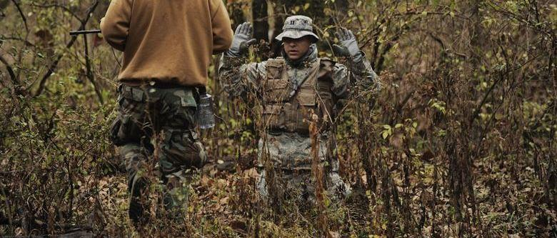 A trainee is caught in SERE training
