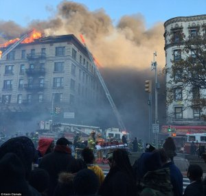 Six-story inferno in Manhattan's Hamilton Heights is raised to FIVE alarms as more than 200 firefighters continue to battle flames