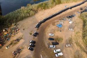 Texas Gov. Abbott sends miles of cars along border to deter migrants