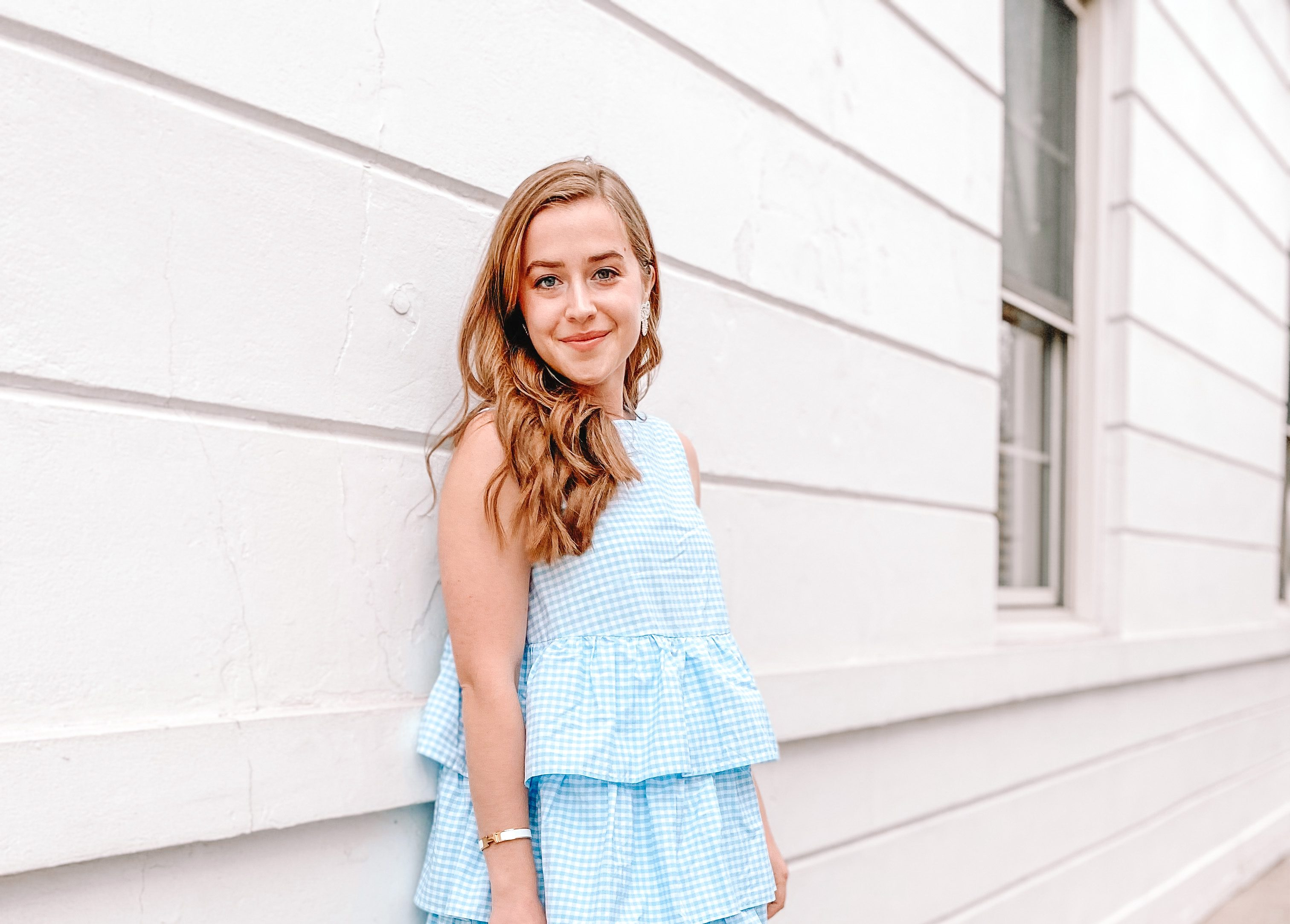 vaccinated girl smiles after covid 19 pandemic in gingham dress