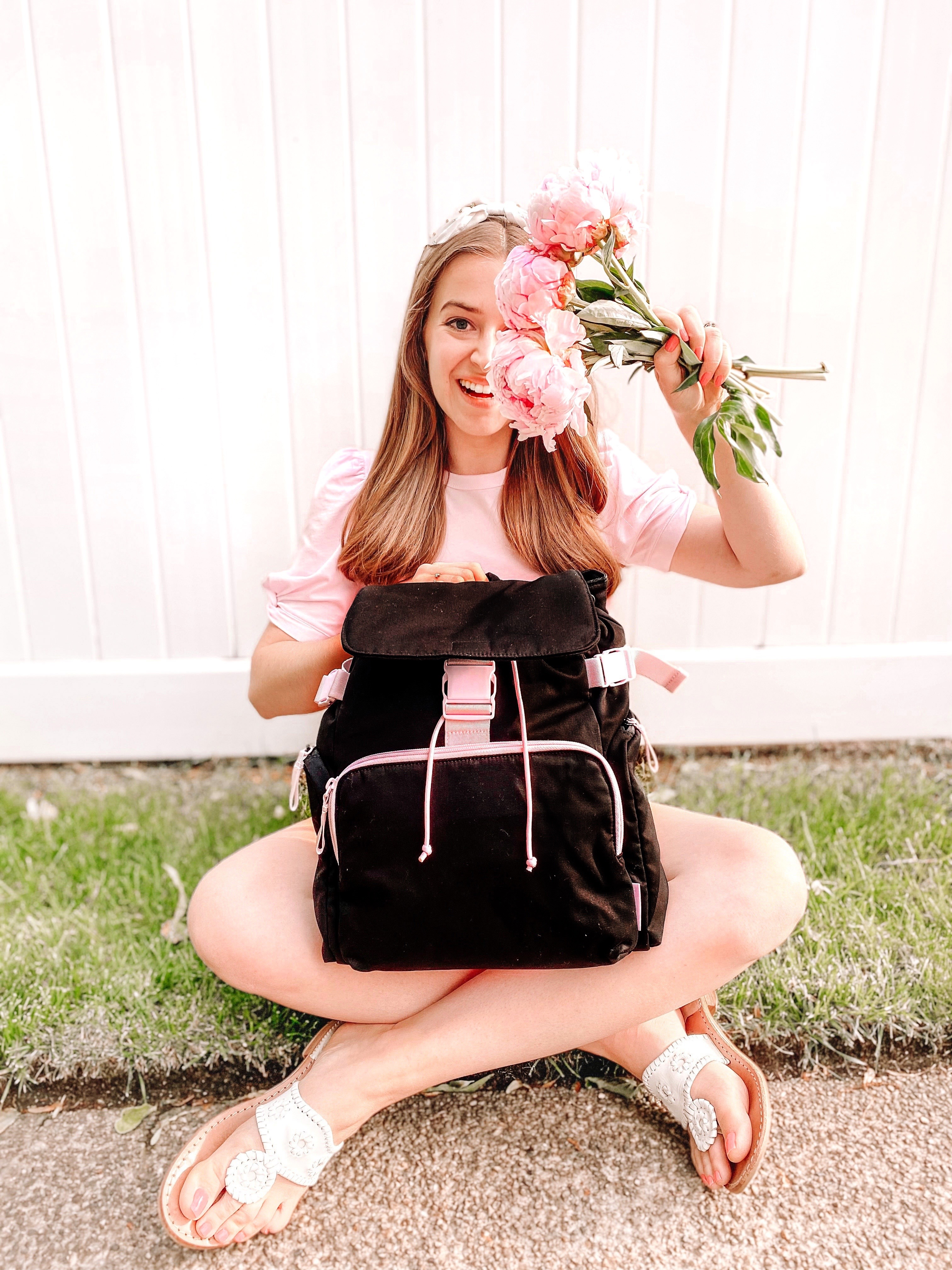 girl poses with vera bradley utility backpack