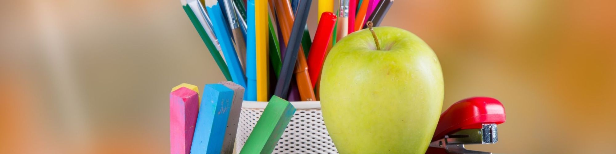 Colored Pencils and an apple
