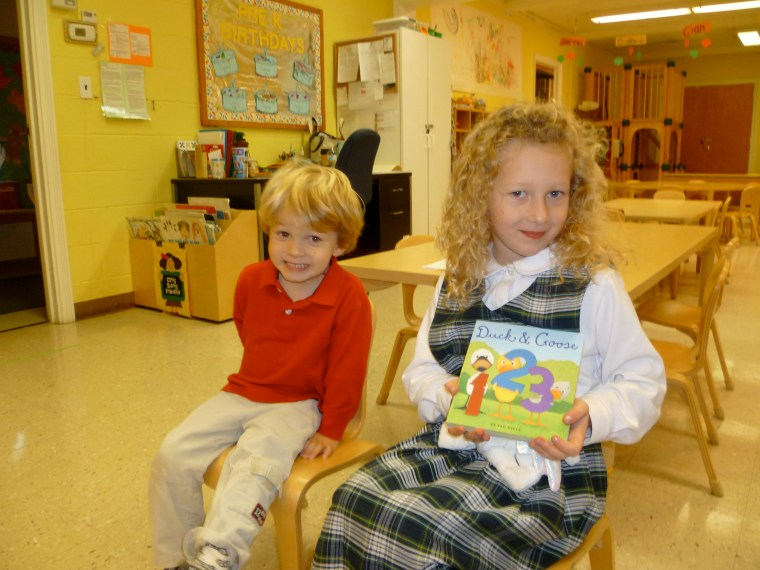An Alumni returns to read to her little brother's class