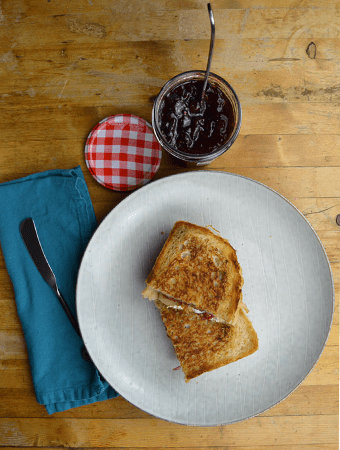 Grilled cheese on plate with jam