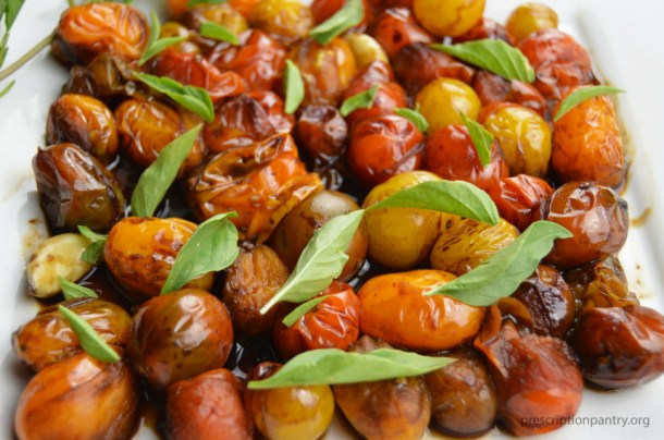 blistered cheery tomatoes balsamic basil leaves