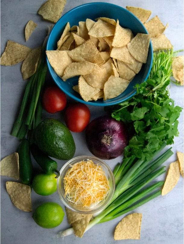 lime tortilla chips avocado tomato cheese