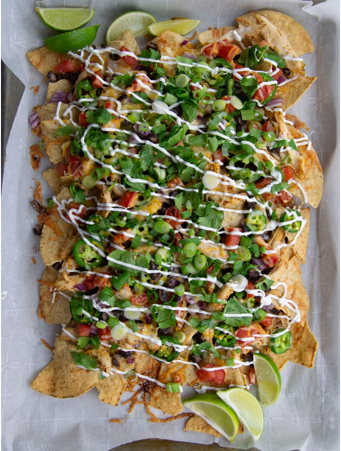sheet pain nachos cheese chicken sour cream limes