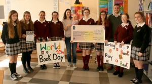Mr Tierney with members of the Pres Currylea Book Club presenting the cheque to Aly Gray and her daughter Robin who represented St. Michael's House