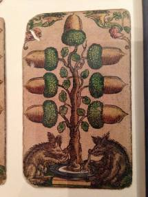 The lower pips in this deck featured scenes of common folks and debauchery.