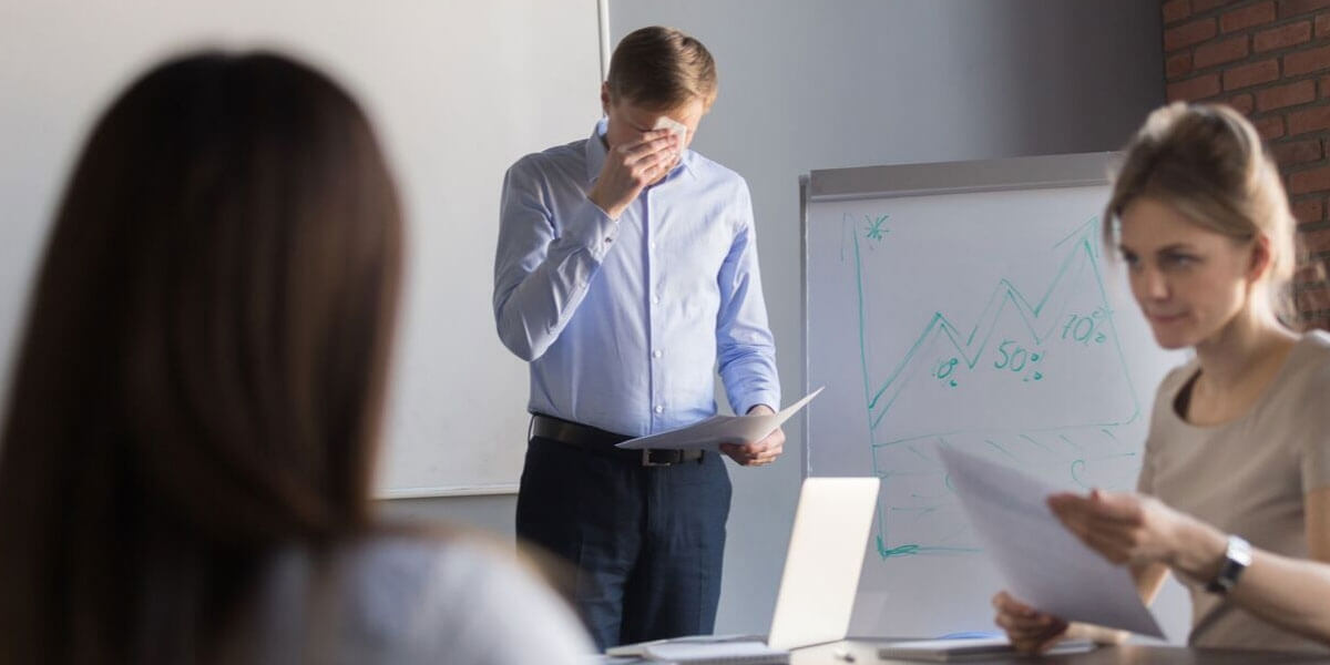 Presenter Realising The Benefits Of Good Presentation Training Whilst Wiping His Brow
