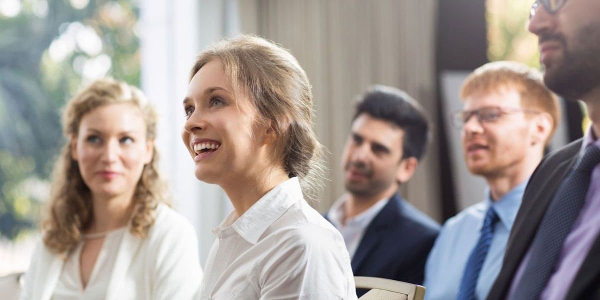 Audience Laughing At Presenter Using Humour In Their Presentation