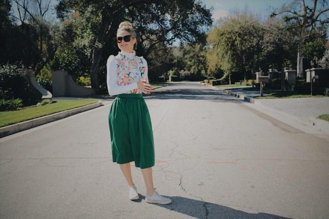 White Turtleneck + Floral Blouse + Green Skirt + White Sneakers
