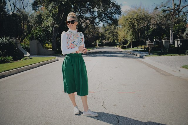 White Turtleneck + Floral Blouse + Green Skirt + White Sneakers