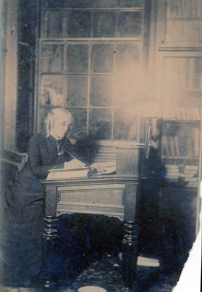 Photo of Martha Stewart in the second-floor library of Carpenters' Hall. Bookshelves, installed in 1868, are still there today. Image courtesy of Carpenters' Hall.
