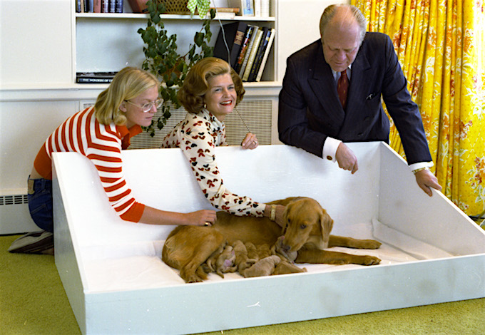 Susan, Mrs. Ford, and President Ford with Liberty and puppies. September 16, 1975.