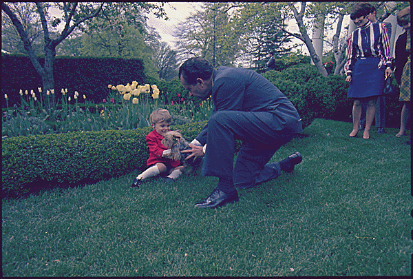President Nixon and Pasha, a Yorkie, meet with David Lupi, the poster child of the National Hearing and Speech Foundation, 1969.