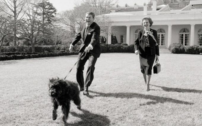 Margaret Thatcher and President Reagan walk Lucky, Feb. 20, 1985.
