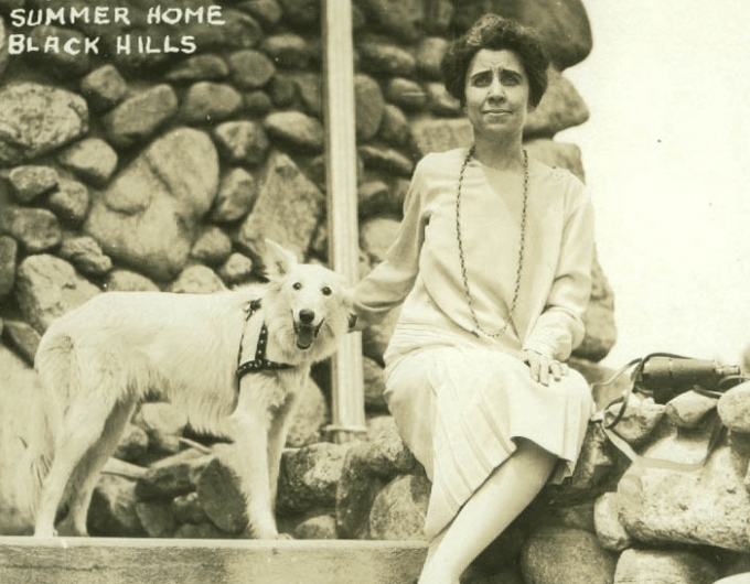 Prudence Prim and Grace Coolidge at the summer home in Black Hills, South Dakota, during the summer of 1927. This was shortly before the dog died.