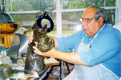 Richard Chashoudian works on a wax sculpture model of Barney, President Bush's dog. (2005 photo)