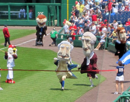 Washington Nationals racing president George Washington crosses the finish line ahead of Teddy Roosevelt, who pulled up the rear while riding a Segway