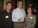 Former Round Table President Rick Wilson, center, with Sara Spataro of Santa Barbara Special Olympics and Blake Dorfman, left, of PresidioSports.com
