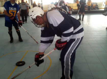 Special Olympics athlete Jose Castrejon demonstrates his Floor Hockey skills.