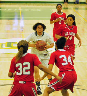 Desirea Coleman looks to pass to a teammate as she is met by Mount Miguel's Deijah Blanks (32) and  Brittany Miller.