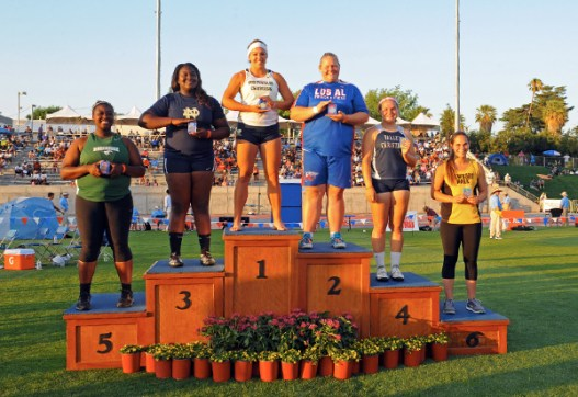 Scarvelis stands atop the podium after winning her third CIF State Championship in shot put. (Leonard Coutin Photo)