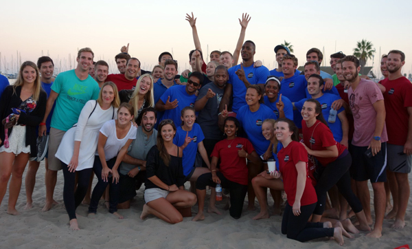 Howard took a group photo after playing in the hour-long kickball game at Santa Barbara's West Beach.