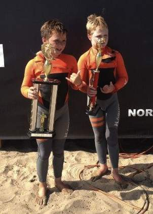Twin brothers Hamilton, left, and Curtis Jacobs show the hardware they won at the NSSA Gold Coast Conference meet at C Street in Ventura.