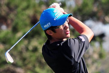 Jesse Yam, pictured teeing off on No. 17, placed second overall.
