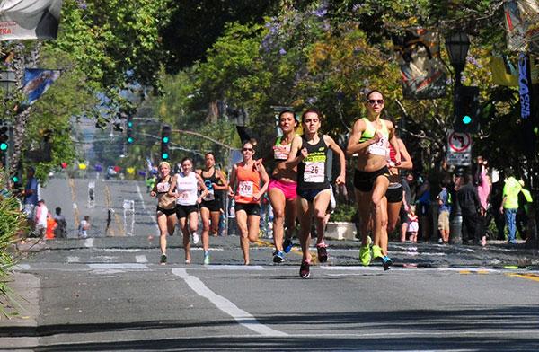 The women's Elite Division races down State Street. (Presidio Sports Photos)