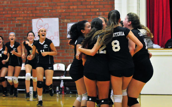 The Warriors celebrate their victory after match point. (Presidio Sports Photos)