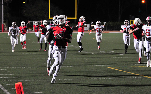 Bishop Diego's AV Bennett races to the end zone on a punt return for a touchdown against Carpinteria. (John Dvorak/Presidio Sports Photos)