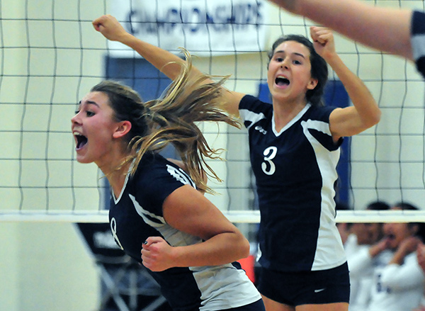 Phoebe Madsen, left, and Maddy Nicolson celebrate after a point during the CIF semifinal match.