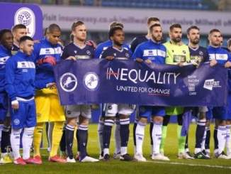Millwall fans applaud as players unite behind anti-racism banner before QPR match