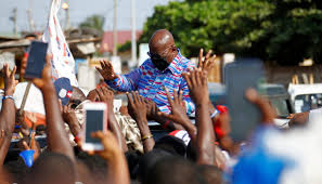 Ghanaians go to the polls in tight race between incumbent and ex-president