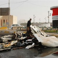 Blasts kill at least 18 people in central Baghdad