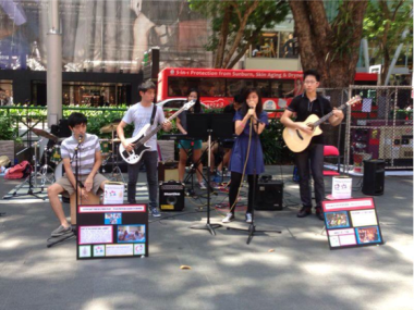The Possum Parade busking along Orchard Road as part of a gig organised by The Humanities Initiative