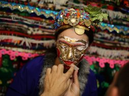 """Bulgarian Muslim bride Lilova gets a special make-up called """"ghelina"""" in front of the dowry during her wedding ceremony in the village of Draginovo"""