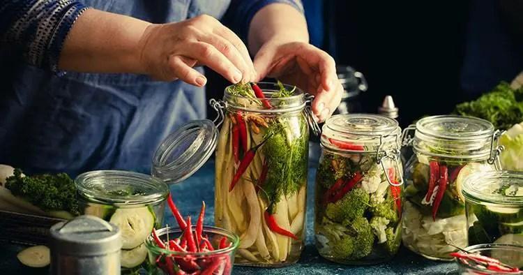 Elder woman canning vegetables