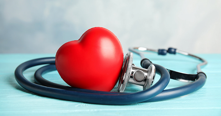 stethoscope-red-heart-on-wooden-table