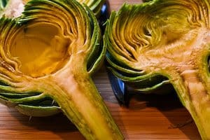 picture of artichokes being trimmed