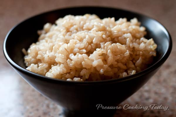 Pressure Cooker Brown Rice in a black bowl