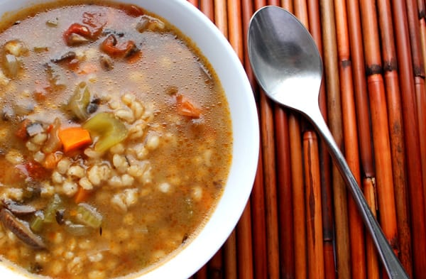 Pressure Cooker (Instant Pot) Portobello Mushroom and Barley Soup in a white bowl with a spoon beside it