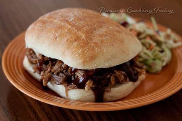 Easy Pressure (Instant Pot) Cooker Pulled Pork Sandwich on a roll with coleslaw
