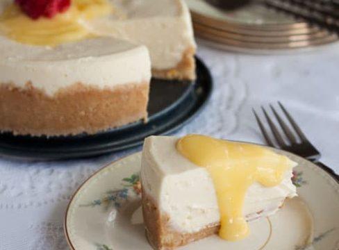 slice of Pressure Cooker ((Instant Pot) Meyer Lemon Cheesecake on a white plate