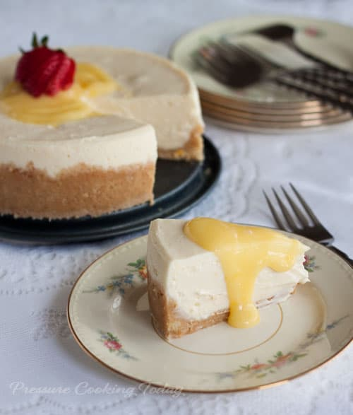 """A rich, creamy Meyer lemon cheesecake """"baked"""" in the pressure cooker in just 15 minutes. Top it with a little tart lemon curd to add a little sunshine to your day."""